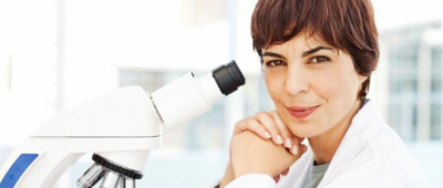 Woman Smiling Alone With Microscope