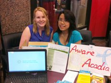 Catherine Cai (right) and fellow student promote ovarian cancer awareness at Acadia University.